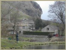 Kilnsey Park Trout Farm with a view of Kilnsey Crag in the Yorkshire Dales